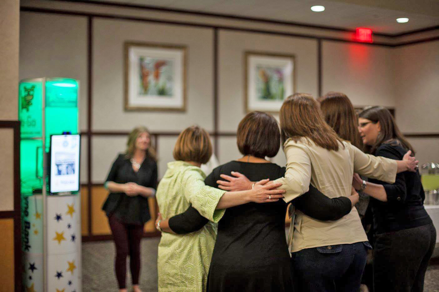 Group of women huddled together networking in Wayne County, Indiana