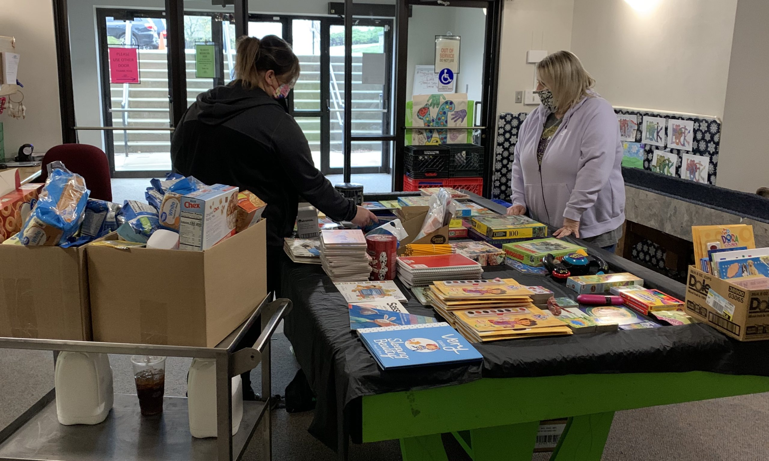 CIS staff organize books and supplies donated for kids during the COVID-19 pandemic.